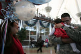 (DLM2299) -   Stephanie Torres watches as her husband Army Sgt. Jose Torres of Englewood holds his...
