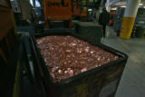 "A cart of ""Cent Blanks"" sit at the mint before they are stamped into pennies on Tuesday..."
