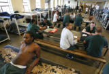 MJM325 Denver County Jail inmate, Garryn Jackson (cq), left, leans on a table as he watches...