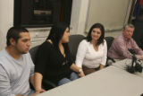 left to right, unidentified man, by his choice, black shirt, Dawn Delgado, sister, looks at...