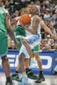 Denver Nuggets guard Allen Iverson gets fouled by Boston Celtics defenders Sebastian Telfair,...