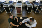 MJM318 Denver County Jail inmates, Jeremy Shadle (cq), left, and Kevin Lozoya (cq) play dominoes...