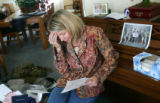 Debra Anderson reads a letter from her son Navy Hospital Corpsman Christopher Anderson that was...
