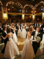 The 2006 Denver Debutantes waltz with their escorts in the rotunda of the Brown Palace Hotel.  ...