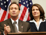 Rep. Ed Perlmutter, (left) D-CO, lends his support to Rep. Diana DeGette, D-Denver, as she holds a...