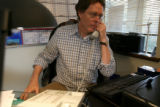 Nick Forster, cq,  CEO. Host of eTown, makes a business call Monday Dec,. 18, 2006 from his office...
