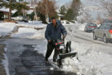 Rodney McAfee (cq) clears ice and snow from the front of his house, 3000 block of S. Holy Place,...