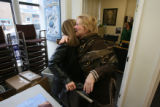 Pat Waak, left, gives a big happy hug to Joan Coplan, left in black coat. (cq both). Pat Waak,...