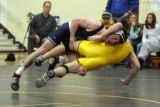 (DLM4463) -   Broomfield's Cory Casady (blue) takes down Thompson Valley's Jeff Phillips during...