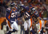 In the fourth quarter, the Denver Broncos D.J. Williams (#55, LB), Karl Paymah (#41, CB) and Ian...