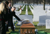 Rick Anderson (cq) cries as he reaches down to touch the casket of his son, Navy Hospital Corpsman...