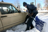 MJM296  Tommy Watkins (cq) helps shovel out the vehicle belonging to Sheryl Rhea (cq) parked on...