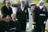 Rear Admiral Lewis Libby, right, salutes after giving the flag to mother Debra Anderson at the...