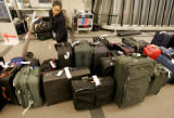 Stefani Vital (CQ) an associate with Continental Airlines searches for a missing Continental bag...