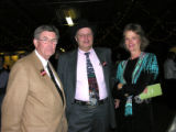 Buck Hutchison, left, with Tracy and Jane Ringolsby. Buck Hutchison, a vice president with the...