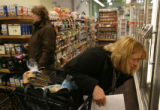 MJM568  Surveying the frozen food section, Lori Nelson (cq), right, of Denver stocks up on food...