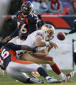 [JPM0509] In the second quarter, Denver Broncos linebacker D.J. Williams (55) drags down San...