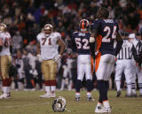 [JPM0696] During overtime, Denver Broncos cornerback Champ Bailey (24) stands by his discarded...