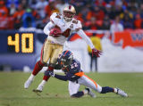 In the third quarter, the San Francisco 49ers Michael Robinson (#24, RB) spins out of the tackle...