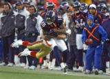 In the third quarter, the Denver Broncos Brandon Marshall (#15, WR) takes the San Francisco 49ers...