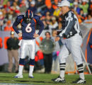 In the first quarter, the Denver Broncos Jay Cutler (#6, QB) hangs his head after being sacked by...
