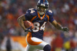 In the third quarter, the Denver Broncos Javon Walker (#84, WR) looks to make a play upfield...
