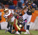 In the fourth quarter, the Denver Broncos Champ Bailey (#24, CB) hauls down the San Francisco...