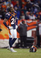 In overtime, the Denver Broncos Champ Bailey (#24, CB) looks up to the scoreboard during the two...