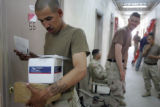 04/12/2005 Iraq-SGT Juan Polino, left, delivers mail as fellow members of Lightning Troop, 3rd...