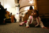 MJM027 Brianna Rodriguez, 9 months, cries for her mother as she crawls down an aisle during...