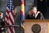 Colorado Governor Bill Ritter, right, receives a hug from his Lieutenant Governor Barbara O'Brien...