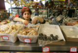 Anna Parikyan (cq), picks out some cookies for a customer at Elite Deli, a Russian and European...