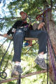 Peter Mortimer rigged in a tree to film climbers in the nearby Cobra Crack, Squamish, B.C., for...