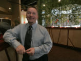 Jeromy Krug operating partner stands in front of his bamboo curtain at the Ling & Louis Asian...