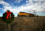 On Dec. 14, 2006, a train passes by a wreath commemorating the 45th anniversary of the train-bus...