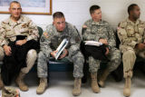 Members of the 43rd ASG (Army Support group) demobilizing from Iraq go wait at a station as they...