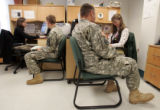 Members of the 43rd ASG (Army Support group) demobilizing from Iraq go through an interview during...