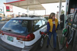 Linda Crosby (cq), of Denver, fills-up her car with gas at a Safeway gas station Monday afternoon...