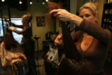 Gina Martinez, (cq), stylist and owner, begins the styling process with a resident (who chose to...