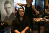 Ashley Gallegos, 18, (cq), gets the beginnings from stylist Tara, (cq), first name only requested,...