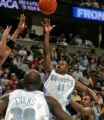 Denver Nuggets guard Earl Boykins hoist up a shot being defended by the Wizards Gilbert Arenas,...