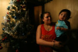 (DLM5061) -   Veronica Rodriguez, 20, holds her 11-month-old son Luis Rodriguez at her...