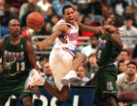 JANUARY 20, 1997-- BUCKS AT SIXERS-- Sixer's Allen Iverson is out of control as he loses the ball...