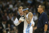 (DLM3103) - After hitting the floor hard Denver Nuggets guard Allen Iverson is helped off the...