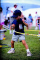 A young concert-goer practices with a Hula Hoop during the Janus Jazz Aspen Labor Day Music...