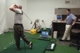 (GREENWOOD VILLAGE, CO., March 24, 2005) Mike Price of Littleton, Co. practices his swing using...