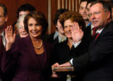Surrounded by family, Doug Lamborn is symbolically sworn in by Speaker of the House Nancy Pelosi...