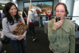 (DLM4274) -  Southwest Airlines marketing manager Kelly Yang, left, uses a prize to bribe...