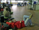Ruben Espinoza (cq) waits in the Greyhound Bus Terminal Thursday afternoon December 21, 2006 in...