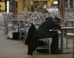 In the food court, a RTD stranded passenger (she didn't want to give her name)  tries to sleep as...